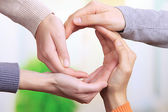 Human hands making circle on bright background — Stock Photo