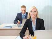 Office workers in workplace — Stock Photo