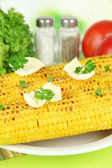 Delicious golden grilled corn with butter on table on bright background — Stock Photo
