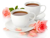 Cups of tea with roses isolated on white — Stock Photo