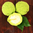 Osage Orange fruits (Maclura pomifera), on wooden background — Stock Photo