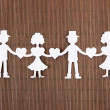 Paper people in social network concept on brown bamboo background — Stock Photo