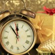 Composition of clock and christmas decorations on bright background — Stock Photo #33192597