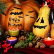 Composition for Halloween with pumpkins and candles close-up — Stockfoto