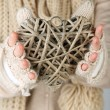 Female hands with wicker heart, close-up — Stock Photo