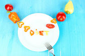Word diet lined vegetables on plate on wooden table close-up — Stock Photo
