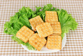 Sandwich crackers with cheese on tablecloth — Stock Photo