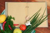 Cooking concept. Groceries with empty cookbook close up — Zdjęcie stockowe