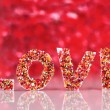 Word Love on red background — Photo