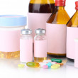 Pills and medicine bottles isolated on white — Stock Photo