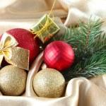 Beautiful Christmas decor on golden satin cloth — Stock Photo #33316187