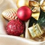 Beautiful Christmas decor on golden satin cloth — Stock Photo #33316189