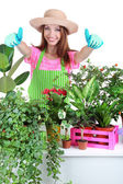 Beautiful girl gardener with flowers isolated on white — Stock Photo