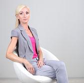 Business woman sitting in office — Foto de Stock