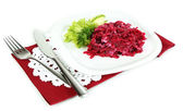 Beet salad on plate on napkins isolated on white — Stock Photo