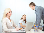 Office staff is during work in workplace — Stockfoto