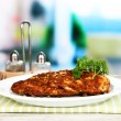 Roasted chicken fillets on white plate on bright background — Stock Photo