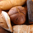 Much bread on wooden board — Stock Photo #33377277