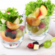 Fruit salad in glasses, on wooden background — Foto Stock