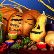 Composition for Halloween with pumpkins and candles on blue background — Stockfoto