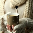Female hands with hot drink, close-up — Stock Photo
