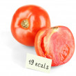 Calorie content of tomato isolated on white — Stock Photo #33378661
