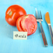 Stock Photo: Calorie content of tomato on wooden table close-up