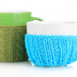 Cups with knitted things on it isolated on white — Stock Photo #33378827
