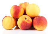 Ripe sweet peaches, isolated on white — ストック写真