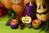 Composition for Halloween with pumpkins and candles close-up — Stock Photo