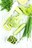 Fresh green vegetables, on wooden background — 图库照片