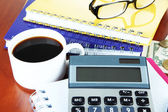 Office supplies with money and cup of coffee close up — Stock Photo