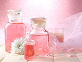 Glass bottles with color essence, on pink background — Stock Photo