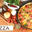 Colorful composition of delicious pizza, vegetables and spices on wooden background close-up — Stock Photo