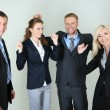 Group of business people on gray background — Stock Photo #33455917