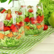 Tasty salad with fresh vegetables on wooden table — Foto de Stock