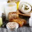 Honey and milk spa with oils and honey on wooden table close-up — Stockfoto