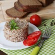 Buckwheat in plate with bread and vegetables closeup — Stock Photo #33452115