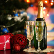 Glasses of champagne and gift on bright background — Stock Photo