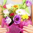 Florist makes flowers bouquet — Stock Photo #33452557