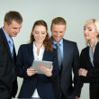Group of business people on gray background — Stock Photo #33455857