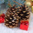 Christmas decoration with pine cones on wooden background — Stok Fotoğraf #33456677