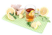 Cup of tea with ginger on napkin isolated on white — Photo