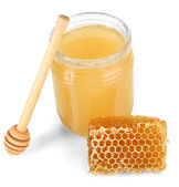 Sweet honeycomb and bank with honey isolated on white — Stock Photo