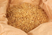 Brown sugar in paper close-up — Stock Photo