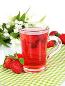 Delicious strawberry tea on table on white background — Stock Photo