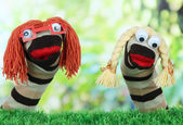 Cute sock puppet on bright background — Стоковое фото