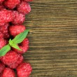 Fresh raspberry on wooden background — ストック写真