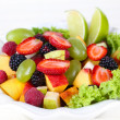 Stock Photo: Fruit salad in plate isolated on white