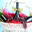 Gift basket with wine on blue background — Stock Photo #33480883